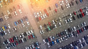 Aerial. Pedestrian crosswalk between parking lot. Aerial. Pedestrian crosswalk between a lot of parking lots with cars royalty free stock image
