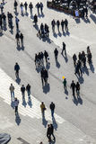 Aerial of pedestrians casting long shadows Royalty Free Stock Photography