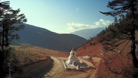 Aerial of the Pele La pass. Flying over the stupa at Pele La pass stock footage