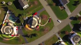 Aerial of Pennsylvania neighborhood with wifi hotspot markers. An aerial bird's eye view establishing shot of a typical Pennsylvania residential neighborhood stock video