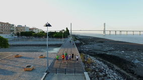 Aerial from people sporting at the Vasco da Gama bridge in Lisbon Portugal. Aerial from people sporting at the Vasco da Gama bridge in Lisbon in Portugal stock video