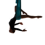 Aerial performer hanging in butterfly pose Stock Images