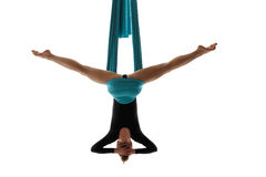 Aerial performer hanging on silk in symmetric pose Royalty Free Stock Photography