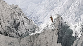 Aerial perspective of hiker standing on peak in snow. Royalty Free Stock Images