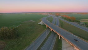 Aerial perspective of interstate commuter traffic crossing bridge on clear stock footage