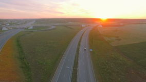 Aerial perspective of interstate commuter traffic crossing bridge on clear stock video footage
