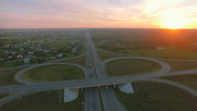 Aerial perspective of interstate commuter traffic crossing bridge on clear stock video