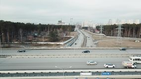 Aerial perspective of interstate commuter traffic crossing bridge on clear, early morning. Video. Aerial Footage of. Highway and Overpass Urban Life with cars stock video footage