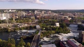 Riverfront Park and Falls in the Downtown Urban Center of Spokane Washington. Aerial perspective of the recreational themed north side of downtown Spokane stock footage