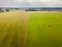 Aerial Photo of Agriculture Fields with Dramatic Skies over them in Early Spring on Sunny Day stock photo