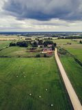 Aerial Photo of Agriculture Fields with Dramatic Skies over them in Early Spring on Sunny Day - Concept of Peaceful Life in. Countryside in Harmony, Vintage royalty free stock photo