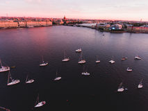 Aerial photo of bay with floating sailing yacht fleet in marina during yachting regatta race Stock Images