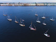 Aerial photo of bay with floating sailing yacht fleet in marina during yachting regatta race Stock Photography
