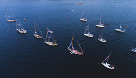 Aerial photo of bay with floating sailing yacht fleet in marina during yachting regatta race Stock Photos