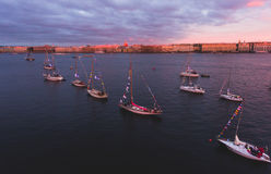 Aerial photo of bay with floating sailing yacht fleet in marina during yachting regatta race Royalty Free Stock Photo