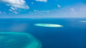Aerial photo of beautiful paradise Maldives tropical beach on island. Summer and travel vacation concept. stock photos