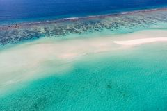 Aerial photo of beautiful paradise Maldives tropical beach on island. Summer and travel vacation concept. royalty free stock images