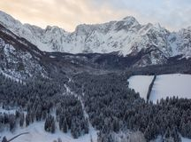 Aerial photo of beautiful winter landscape with snow covered trees in Italy stock photography