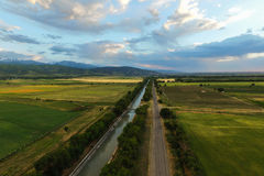 Aerial photo of Big Almaty Canal. Aerial photo of fields,mountains and Big Almaty Canal. Photo was taken near Almaty,Kazakhstan. June 2015 Royalty Free Stock Images