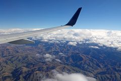 Mountains of South Island of New Zealand from plane. Aerial photo of the brown mountains near Christchurch on the southern part of Aotearoa stock images