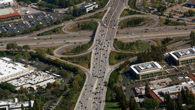 Aerial photo of busy highway intersection. Busy highway intersection with many lanes and ramps Royalty Free Stock Image