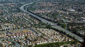 Aerial photo of busy highway. With many lanes traversing populated area Royalty Free Stock Photo