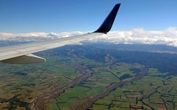 Fields and rivers of South Island of New Zealand from plane. Aerial photo of the Canterbury Plains near Christchurch on the southern part of Aotearoa royalty free stock photography
