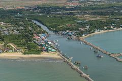 Aerial photo of Cha-am pier in  Phetchaburi Province, Thailand shows many fishing boats parked at the port. Preparing to go to catch fish in the blue sea on a royalty free stock images