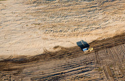 Aerial Photo Construction site. Earth moving truck on large large construction site showing lots of disturbed soil and dirt. An Indiana aerial photo stock images