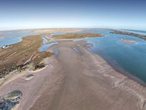 Aerial Photo of the Coorong. Aerial photograph of the River Murray Mouth in South Australia. Murray River Mouth flows out to the ocean with sandbars all around Royalty Free Stock Photography
