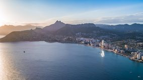 Aerial photo of costal town with view point from the Peñon de Ifach. Prety summer sunset. Calpe, Alicante province, Costa Blanca. Spain stock photos