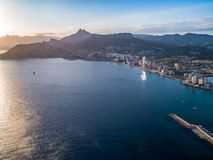 Aerial photo of costal town with view point from the Peñon de Ifach. Prety summer sunset. Calpe, Alicante province, Spain 2. Aerial photo of costal town with stock image