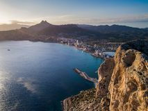 Aerial photo of costal town with view point from the Peñon de Ifach. Prety summer sunset. Calpe, Alicante province, Spain. Aerial photo of costal town with stock images