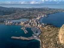 Aerial photo of costal town with view point from the Peñon de Ifach. Prety summer sunset. Calpe, Alicante province, Spain 3. Aerial photo of costal town with stock photos