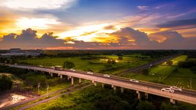 Aerial Photo Countryside Car Running on Road Bridge Over Railway. And Golden Hour Sky Beautiful Landscape Drone View Royalty Free Stock Image