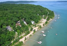 Aerial photo crystal lake Michigan. Aerial photo - Summer lake homes on the south shore of crystal lake in beulah michigan in benzie county royalty free stock photo