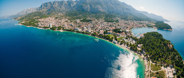 Aerial Photo drone Makarska, Croatia. Coast city, sea and mountains Stock Photos