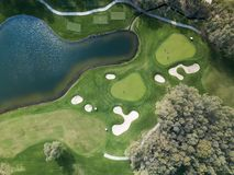 Aerial photo of green golf fields in spring stock image
