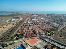 Torrevieja townscape. Aerial photo of harbour, residential suburban houses, highways and Mediterranean Sea of Torrevieja. High angle view townscape, travel stock photography