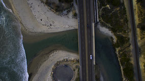 Aerial Photo of a High Way Near the Body of Water Royalty Free Stock Image