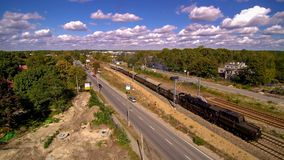 Passage of historic steam locomotive in Wawer in Poland. Aerial photo of historic train in Miedzeszyn in Warsaw. Ty-42-107 Steam engine from Chabówka open air royalty free stock photo