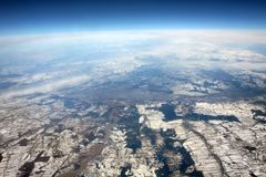 Aerial photo with horizon. View from airplane. Aerial photo from Europe. View from airplane on winter. Europe from above. Aerial view of parcels. A part of Royalty Free Stock Images