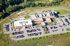 Aerial photo hospital health building. New and busy health care facility aerial photo stock photo