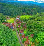 Aerial Photo of Houses Near Road Surrounded by Forest stock images