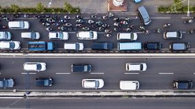 Aerial photo of Jakarta hectic traffic at peak hour. With motorcycles and cars on the road Royalty Free Stock Photos