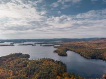 Autumn over a lake in New Hampshire royalty free stock image