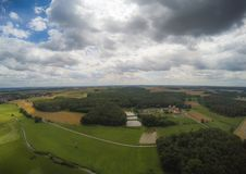 Aerial photo of the landscape near the city of Herzogenaurach in Bavaria in Germany. With cloudy sky Stock Image