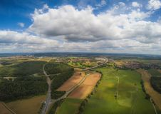 Aerial photo of the landscape near the city of Herzogenaurach in Bavaria in Germany. With cloudy sky Royalty Free Stock Photo
