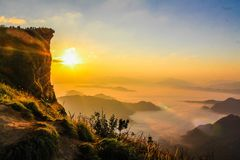 Aerial Photo of Mountain Surrounded by Fog Royalty Free Stock Photo