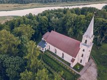 Aerial Photo of an Old Lutheran Church in Countryside Between Trees in Early Spring on Sunny Day, Close up - Concept of Harmony stock photos
